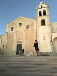 Joy standing in front of church building