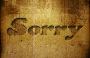 sorry in woodgrain